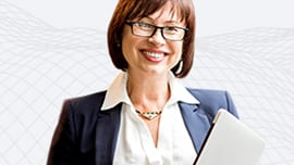 Woman in a business suit holding a tablet and smiling